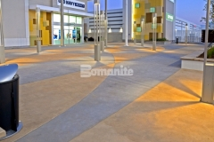 This distinct decorative concrete paving features an interior checkerboard pattern that was inspired by the racetrack infield at the nearby Daytona International Speedway and the use of Bomanite Integral Color with two-tone coloration will provide longevity and durability of color.