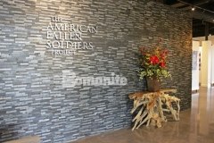 The American Fallen Soldiers Project National Gallery features Bomanite Patene Teres custom polished concrete that was colored with Bomanite Black Orchid concrete dye and the finished flooring surface is durable and beautifully distinctive.