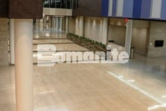 The Bomanite Renaissance Deep Grind System is a polishing technique that is becoming a standard in school construction and was installed at Olathe West High School to create a two-inch thick unbonded and polished concrete topping slab with local aggregates that were exposed during the grinding process and then polished to create a semi-gloss concrete finish.