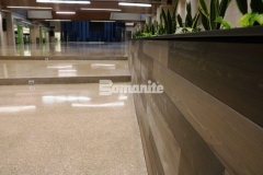 Bomanite Renaissance Deep Grind custom polished concrete was installed here by our colleague Musselman & Hall Contractors to provide a sustainable, low maintenance topping and polishing option, and their installation includes a custom mix of individually sourced aggregates, sands, and integral coloring that fits in perfectly at Olathe West High School.
