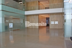 Bomanite VitraFlor was utilized here to create this stunning decorative concrete flooring and the 1,500-grit polish and salt and pepper finish add warmth and elegance to the lobby space inside the Cypress Waters Business Complex.