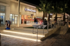 Bomanite Alloy was used to create this decorative concrete step plaza and handicap ramp and the incorporation of the seashell exposed aggregate resulted in a beautifully unique and durable finish that enhances the beach-industrial aesthetic styling at the Tanger Outlets in Daytona Beach, FL.