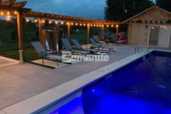 Bomanite Revealed Exposed Aggregate decorative concrete was installed here to create new pool decking, adding durability and distinct design detail like the scattering of mirror glass to make it the perfect space for daytime relaxation and upscale evening gatherings.