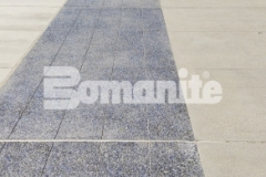 This new sidewalk and accessible driveway were created using Bomanite Revealed with light and dark blue glass, black granite aggregates, and Bomanite Seal Gray Integral Color, a combination that offers non-skid properties and abrasion resistance and make it an ideal choice for this space at Valley Children's Hospital.