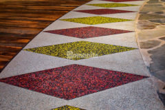 Bomanite Revealed glass aggregate decorative concrete was installed inside the Choctaw Cultural Center and although this application is traditionally meant for exterior applications, the client desired an exposed look, which provided a rich and resilient finish for the entryway surfaces and the circle surrounding the firepit.