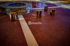Bomanite Revealed features specialty aggregates and the application shown here includes solid glass aggregates in white, black, red, and yellow, which were perfect to create a vibrant diamond border and the brass divider strips set apart the different colors of glass aggregates and enhance the highly decorative and durable finish.