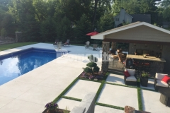 This beautiful backyard resort features Bomanite Revealed decorative concrete that was cast in place with a white base, hand seeded with Georgia white marble, and then exposed to create this stunning pool deck and coping that is light and cool, even on hot summer days.
