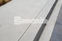 The hardscape design at 50 Fifty DTC incorporated saw cuts that were used to create relief joints and to add a distinctive design aesthetic, with joints that radiate toward the building in diverging rays as well as radius cut joints that were illuminated to mimic the LED lights that were integrated overhead.