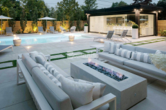 Bomanite Toronto skillfully installed Bomanite Sandscape Refined decorative concrete to create a sleek backyard patio and pool deck in this backyard space, providing the homeowners with a durable surface that was designed for entertaining and easy maintenance and earning the 2019 Honorable Mention Award for Best Bomanite Exposed Aggregate Project under 6,000 SF for their outstanding workmanship.