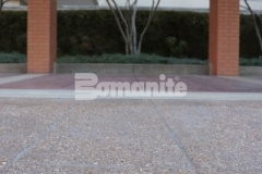 The Residence Condominiums ownership enlisted Musselman & Hall Contractors to renew their aging pavement at the front entrance using Bomanite Bomacron English Sidewalk Slate imprinted concrete with a Bomanite Sandscape Texture Exposed Aggregate finish, providing a hardscape surface that with style and functionality.