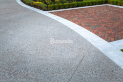 Our colleague Bomanite Toronto installed Bomanite Sandscape Texture decorative concrete to create this beautiful front driveway, enhancing the home's design while providing a durable paving surface – their skillful installation earned them the Silver Award for Best Bomanite Exposed Aggregate Project.