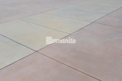 Bomanite Sandscape Texture decorative concrete was installed here in three different colors to create a beautiful courtyard area with a cohesiveness that perfectly connects multiple exterior spaces.