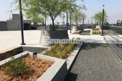 Bomel Construction Company expertly installed a gray Bomanite Exposed Aggregate Sandscape Texture finish to these lineal planters and circular tree planters, adding beautiful textural detail to the hardscape.