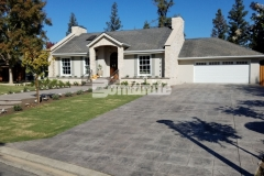 Our colleague Heritage Bomanite transformed the front and back yards of this Fresno, California residence by utilizing Bomanite Imprint Systems to create the driveway, walkways, and back patio and the English Sidewalk Slate Bomacron pattern that was chosen, allowed them to enhance the cozy cobblestone cottage design while providing a durable, decorative concrete surface.