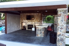 Bomanite imprinted concrete was installed here to create a distinctive and decorative cabana flooring, using an integral gray color for the base that was stamped with the Bomacron Slate Texture pattern, and then antiqued and color washed in a darker gray to create this perfect cozy retreat.