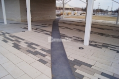 Bomanite Sandstone imprinted concrete was installed here to create accent borders in this pavilion area that delineate the concrete pavers and enhance the overall design aesthetic of Redbud Festival Park in Owasso, Oklahoma.