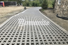 The Bomanite Grasscrete Pervious Concrete System was installed here to create a pervious concrete driveway that will maintain strong structural integrity while mitigating drainage issues and maintaining strong structural integrity.