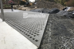 This beautiful hardscape surface features Bomanite Grasscrete pervious concrete that was installed here to create access for large delivery vehicles while providing a permanent solution for stormwater management.
