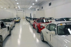 Bomanite Toppings Systems using Florspartic100 showing a Private Residence and a Private Car Collection.