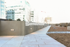 Bomanite Micro-Top ST was applied here as a decorative concrete overlay with a sand-finished surface to create planter walls and planter boxes that reflect the urban lifestyle design at this mixed-use luxury condominium development.