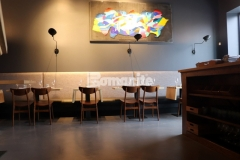With multiple flooring surfaces to cover, Bomanite Micro-Top was the perfect choice to renovate the floors inside the Elmwood neighborhood restaurant because it tenaciously bonds to virtually any substrate and resulted in cohesive flooring that is a distinctive design element inside this space.