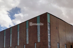 Featured here is the Bomanite Paténe Artectura topically applied coloration system that was chosen to create a semi-weathered, antiquing effect on the vertical concrete panels that make up the exterior of the Beast Urban Park recreational facility in El Paso, TX and after the acid-based stain was applied to the already installed panels it was finished with an acrylic sealant to ensure that the application will last a lifetime in the arid El Paso climate.