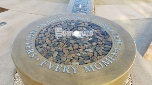 """Close up of the brass words """"Every Moment Matters"""" in the fountain created with Bomanite decorative concrete at the Clovis Medical Center housing the Clovis Cancer Institute."""