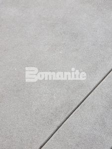 Close up of the Bomanite Sandscape Refined Exposed Aggregate decorative concrete installed by Colorado Hardscapes at the 50 Fifty DTC building in the Denver Tech Center.