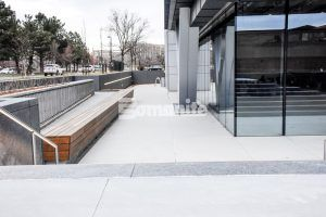 Exterior view of the walkways of the 50 Fifty DTC building in the Denver Tech Center with Bomanite Sandscape Refined Exposed Aggregate decorative concrete installed by Colorado Hardscapes.