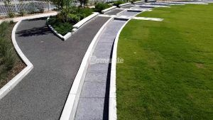 Longer view of the water feature riverbed of decorative concrete running throughout the Owasso Redbud Festival Park in Owasso, OK, installed by Bomanite of Tulsa.