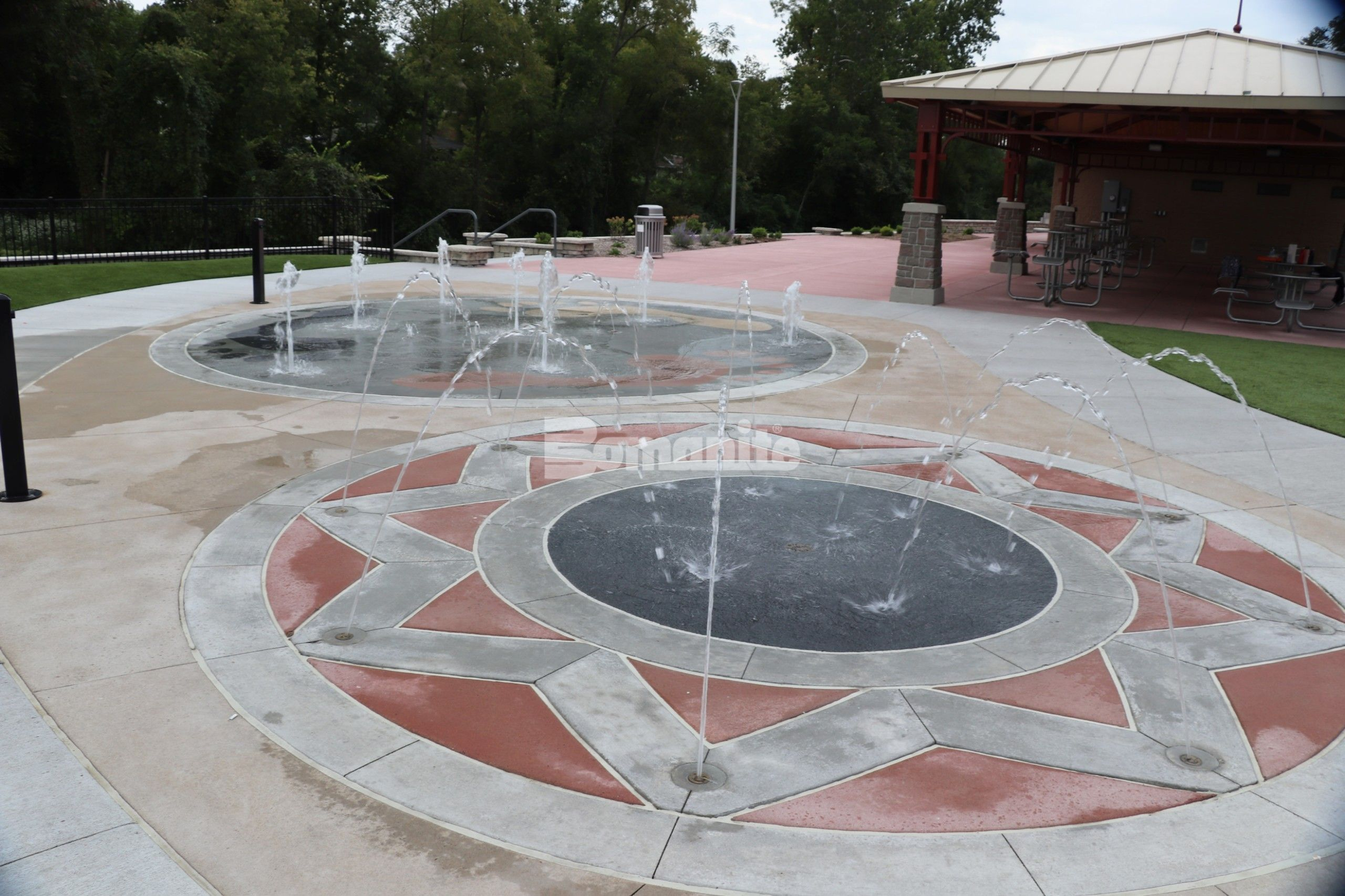 Bomanite Sandscape Texture Exposed Aggregate System with Bomanite Con-Color for a fun splash pad for everyone to enjoy at the Community Park in Jefferson City, MO, installed by Bomanite Licensee Musselman & Hall Contractors, LLC.